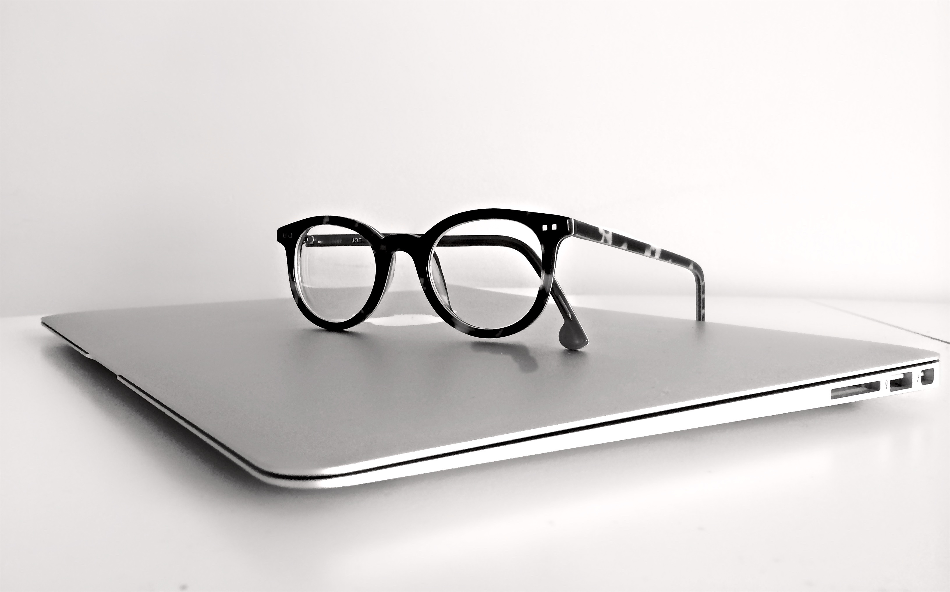 mac laptop and glasses