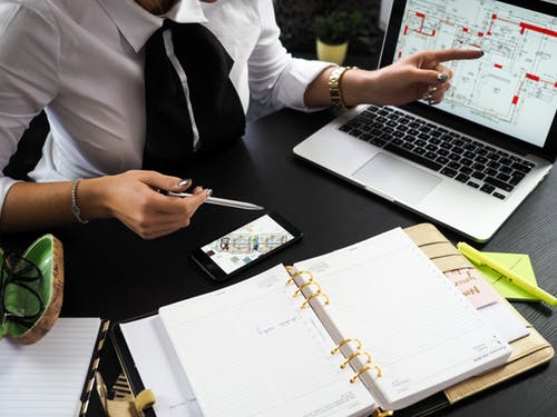 planner looking at schematics to calculate event ROI